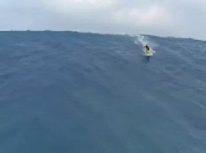 Mike Parsons catching a big wave at Jaws